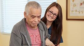 nurse helping older man