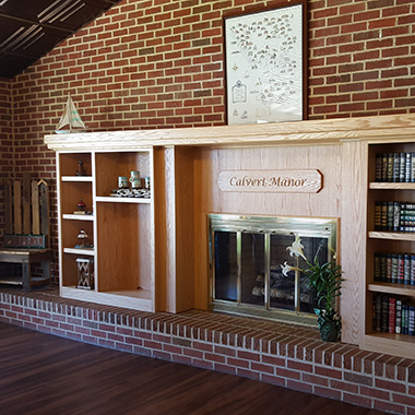 Calvert Manor brick fireplace in recreation room