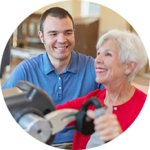 man helping older woman with rehabilitation