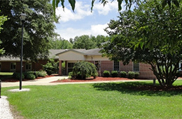 Caroline Nursing expansive front lawns and mature trees