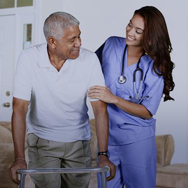 nurse assisting a resident using a walker