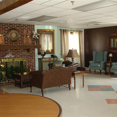 Recreation room with lots of seating and a cozy brick fireplace