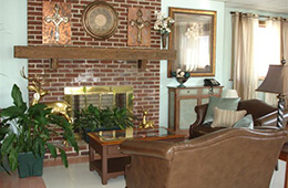Long View cozy community area with leather couches and a brick fireplace