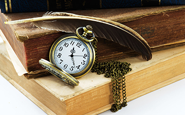 26565280 - vintage grunge still life with antique pocket watch, and old book ,quill