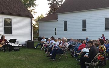 Ohio Disciples do their work outside the church doors
