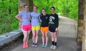 Four Girls Standing at Start of Running Path