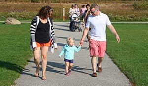 Family Walking on Paved Trail