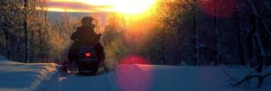 Person on Snowmobile in Geauga Park at Sunset