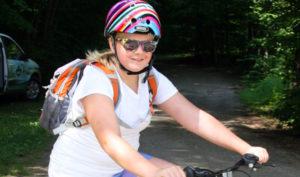 Girl Biking with Helmet