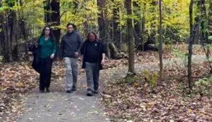 People Walking on Claridon Woodlands Trails
