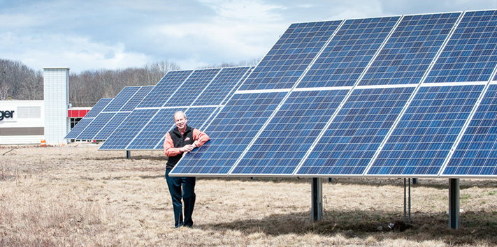 Peter Geiger stands with Solar Panels at Geiger's Facility in Lewiston, Maine