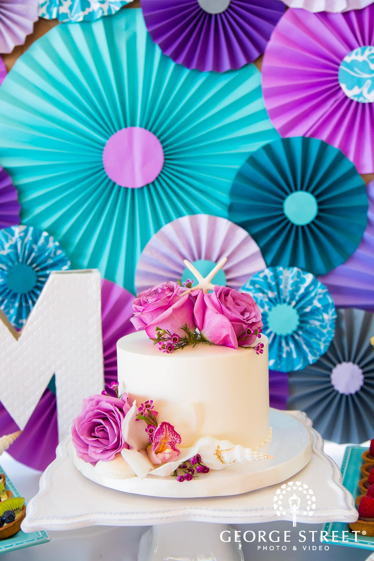 colorful beach wedding cake display