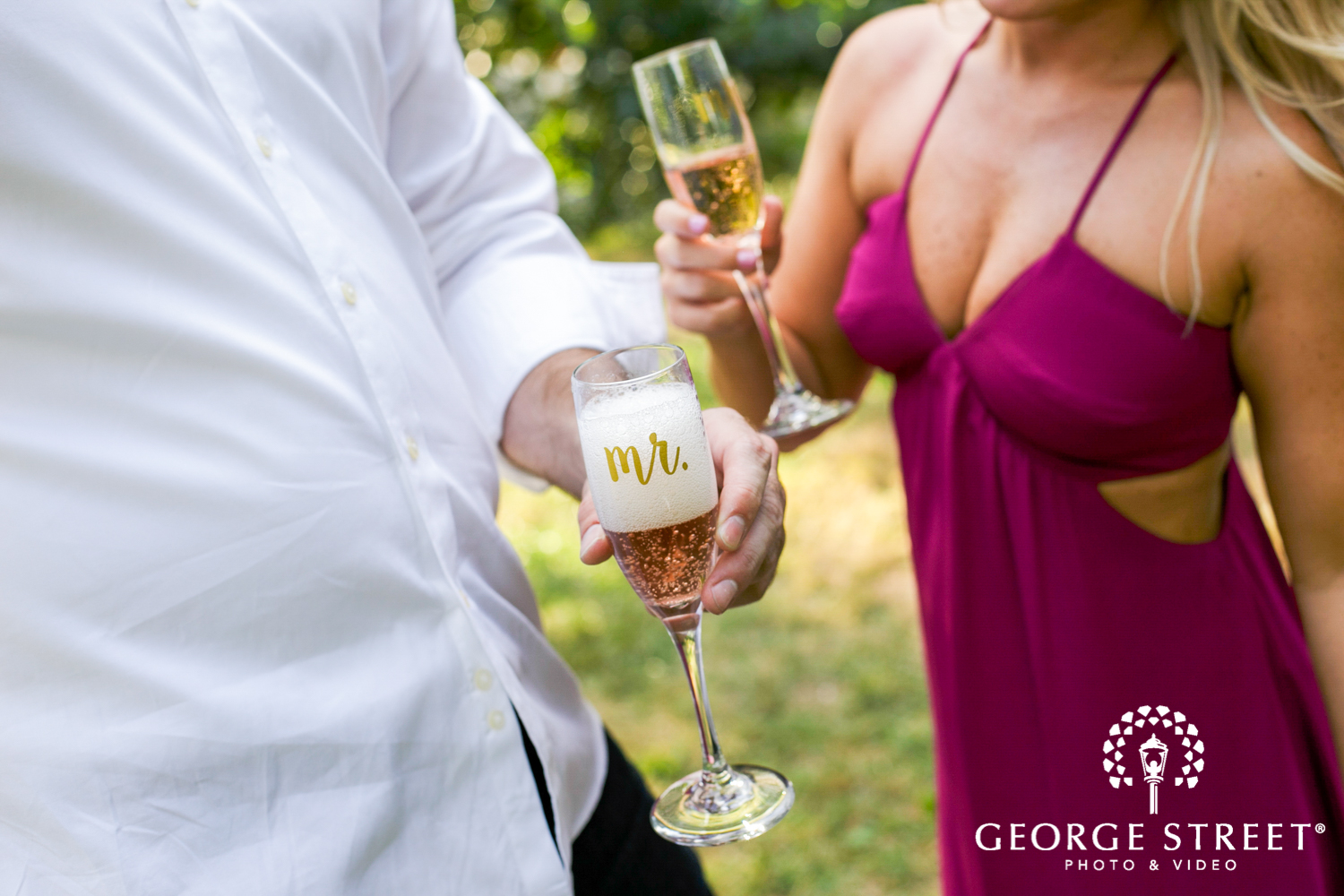 champagne toast engagement photos