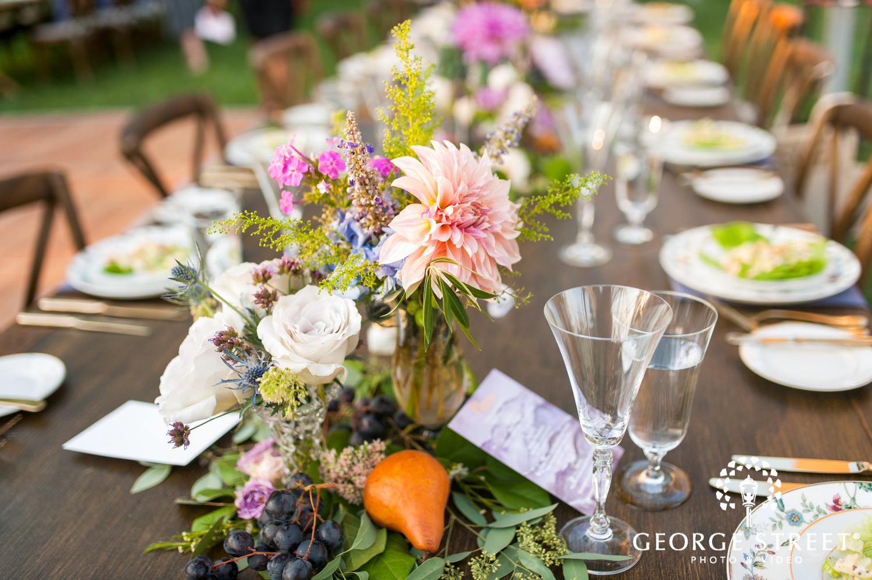 warm floral wedding reception table decor