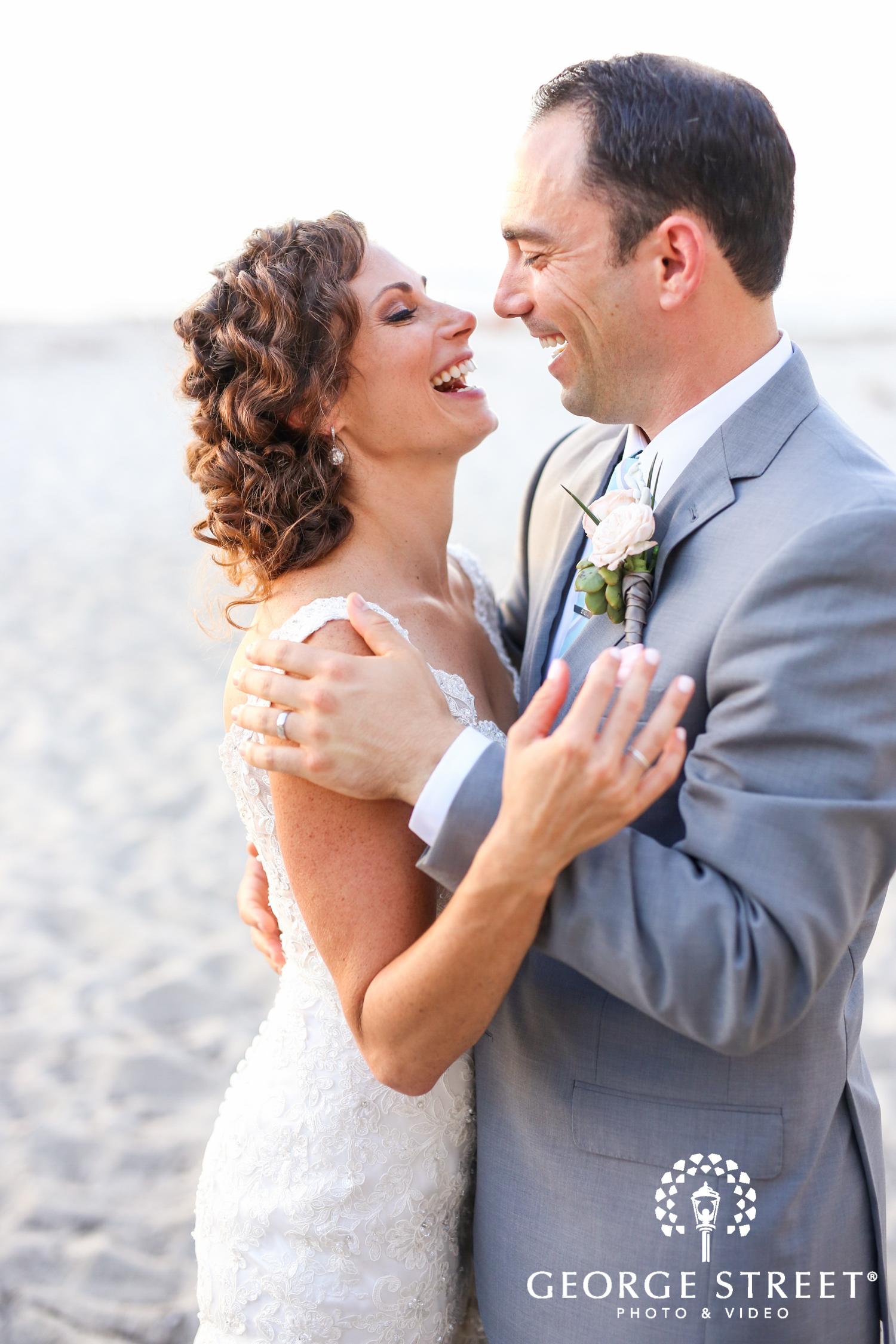 candid beach wedding couple