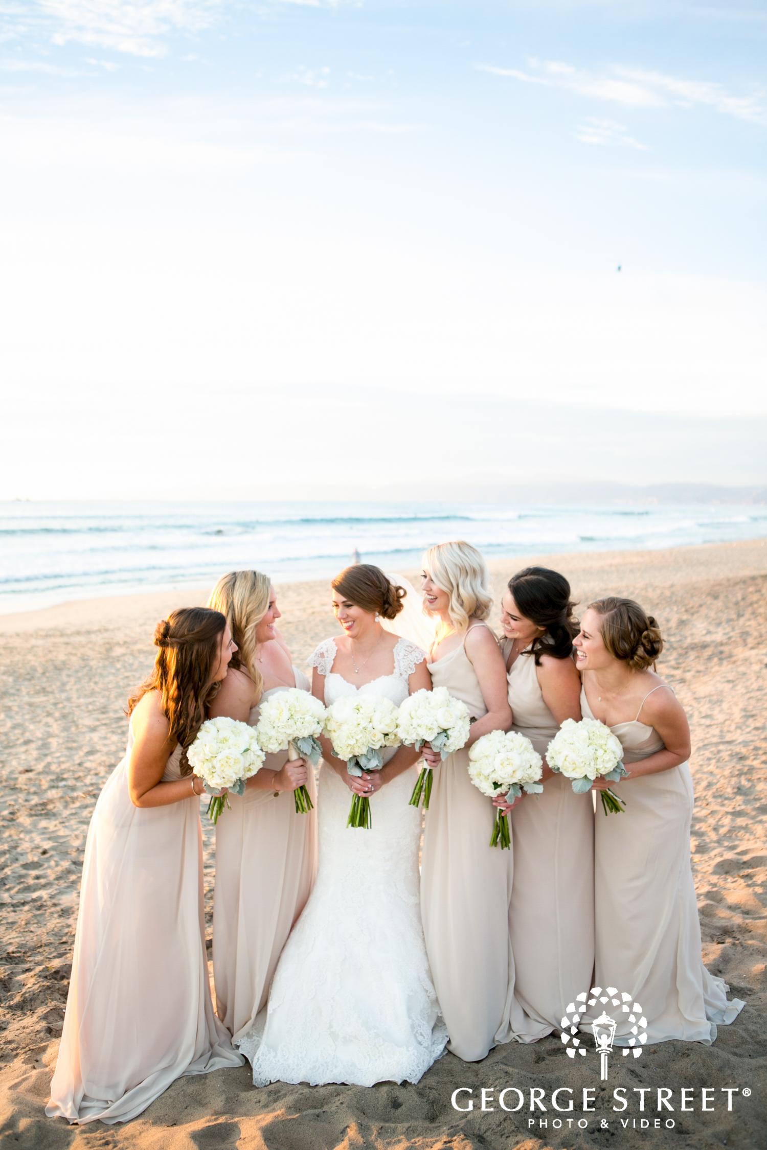 blush beach bridesmaids photo