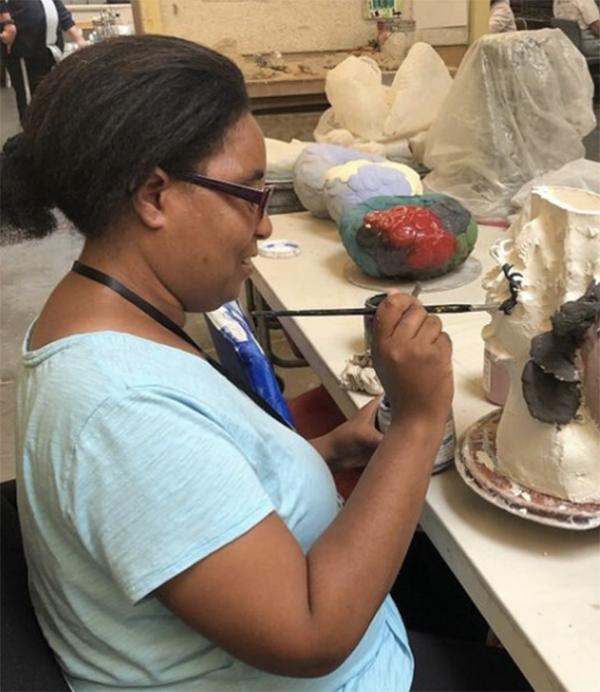 Raven Harper, NIAD Artist, creating a ceramic face vase.
