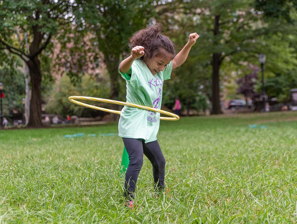 Athlete playing hula hoop