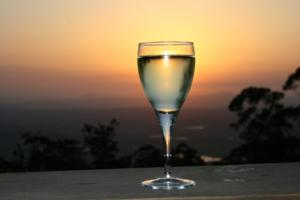 Avocado Sunset a glass of wine as the sun sets