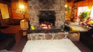 Cosy woof fire central in guest lounge-dining area