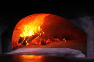 Our beautiful wood fired oven creates an ambience