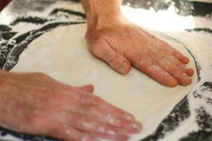 We make our dough, stretch our dough and bake it