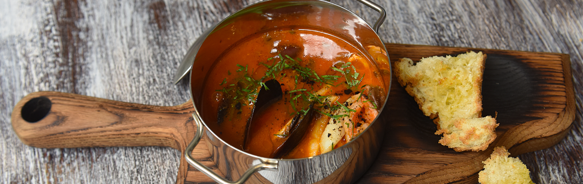 Fresh shellfish steamed in a simple tomato, garlic and fresh herb broth with a touch of chilli image