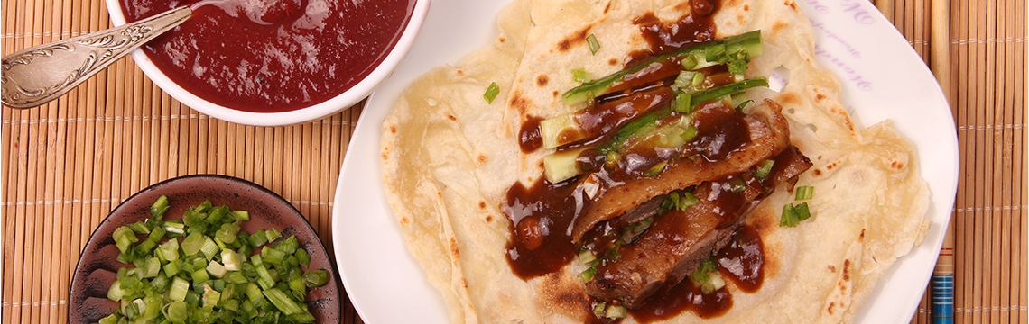 Crispy five spice scented, Peking Duck pancakes, hoisin sauce, Asian greens. image