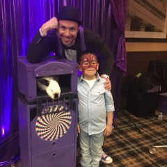 Zain the magician with birthday child
