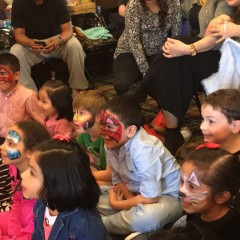children at party magic show with face painting