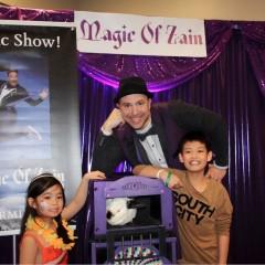magician, rabbit, two children