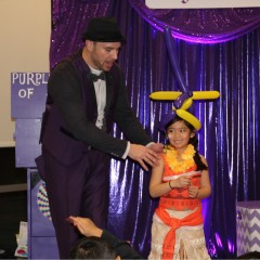Zain the magician performing with children
