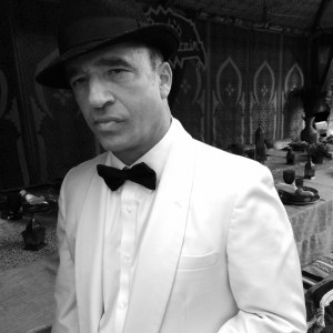 Ellis Martin as Humphrey Bogart - Impersonator / Radio DJ in Los Angeles, California