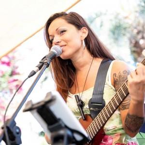 Tsurita - Singing Guitarist in New York City, New York
