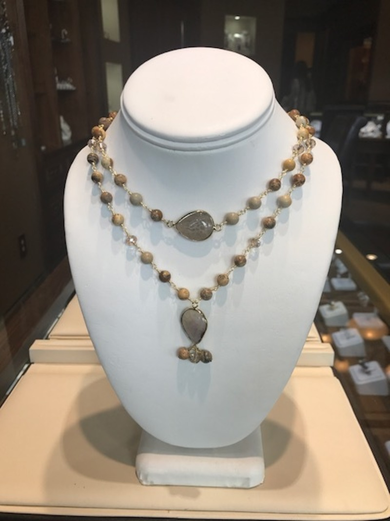 Sunstone bead double necklace with pear-shape quartz stones.