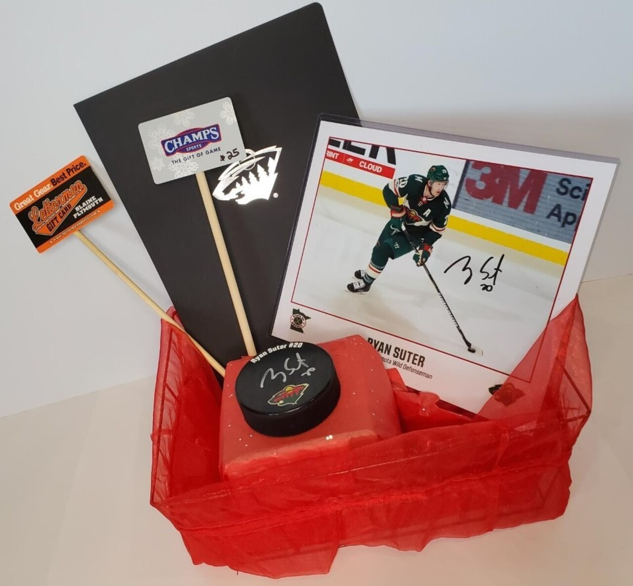 401. Signed Ryan Suter Puck and Photo