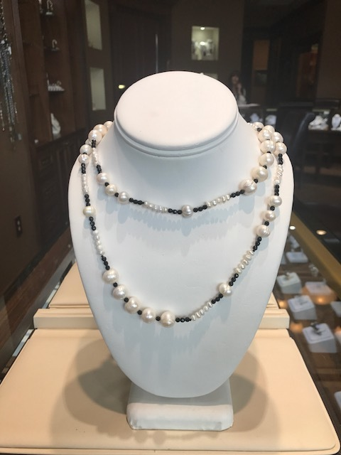 Freshwater pearl and jet bead long necklace.