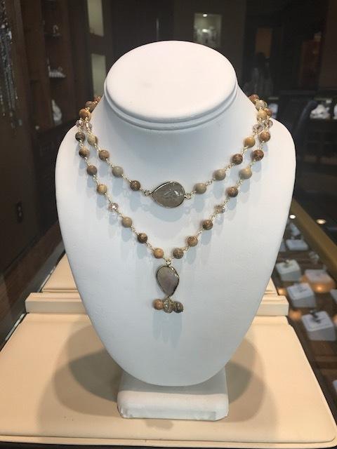 Sunstone bead double necklace with pear-shape quartz stones.