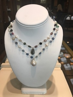 Sterling silver double bead necklace with freshwater pearls, blue and multi-color stones.