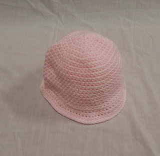 Hat: pink with flared brim