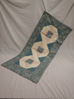 Quilted table runner donated by Carol Turkett, member of SAWS2