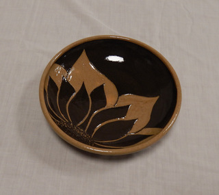 Ceramic Sunflower Bowl, made by Donna H. Perry, member of CarpentHERS