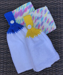 Crocheted Pot Holders and Dish Towels with Crocheted hangers made by Joanne Palermo, member of CarpentHERS