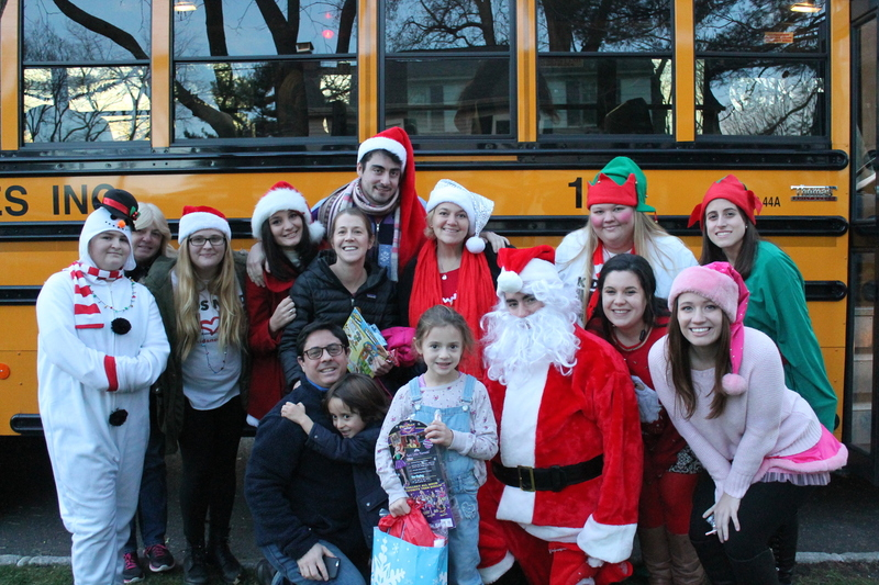 Filling the HoLiDAY CHEER BUS with GiFTS & SMiLES