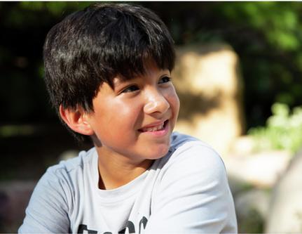 Hispanic boy looking up