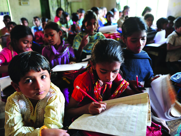 Children sitting in a school in India