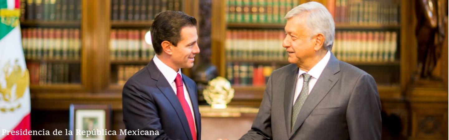 Enrique Peña Nieto and AMLO shaking hands