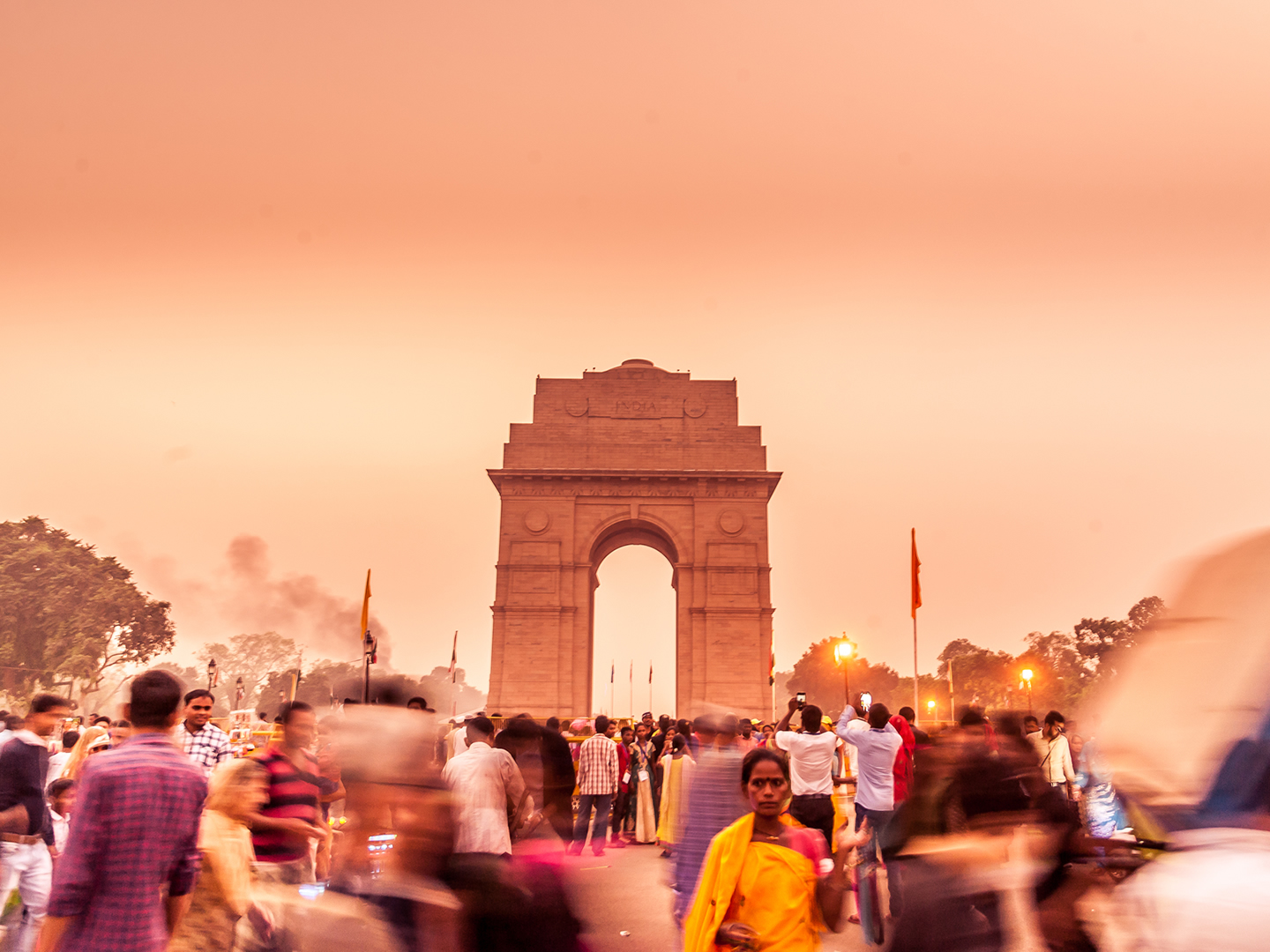 Crowds around the India Gate at sunset