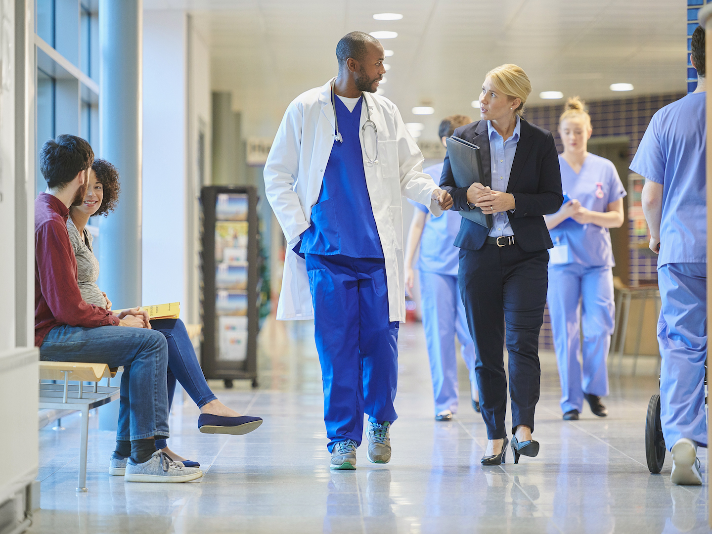 Doctors Walking in Hospital Hallway