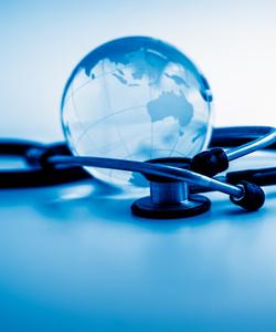 Stethoscope wrapped around glass globe